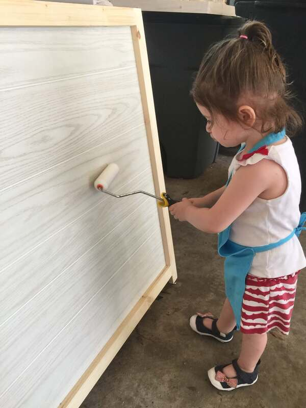 Little Girl Painting Assistant