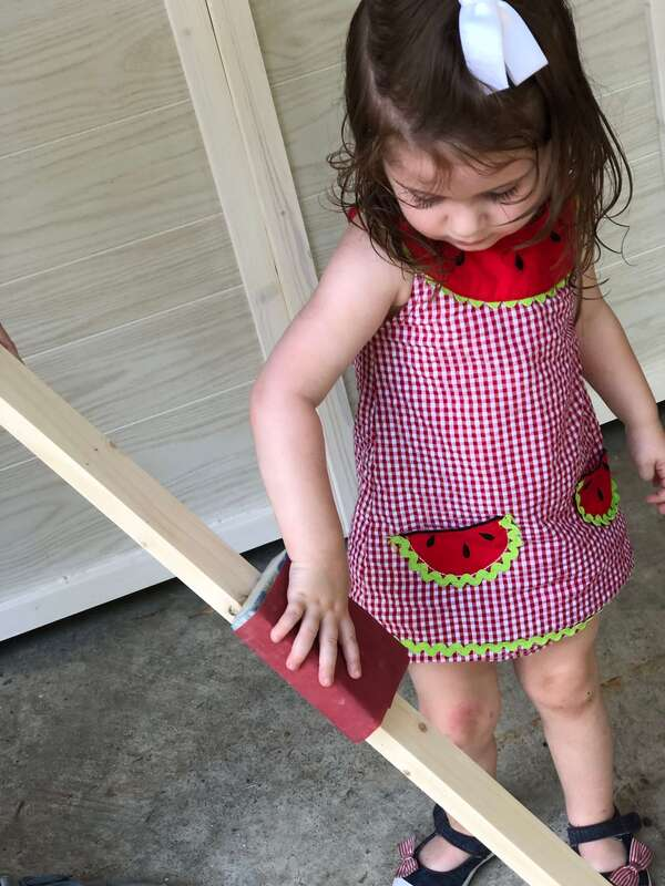 Little Girl Sanding